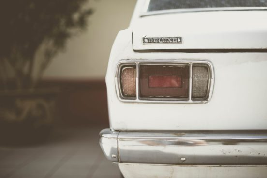 a white vintage car from behind