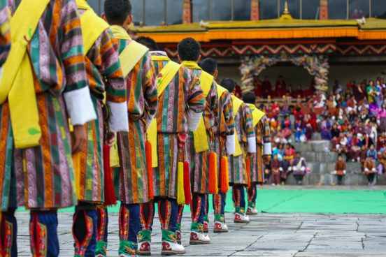 male dancers get ready for a traditional dance during Thimphu Tshechu (festival)