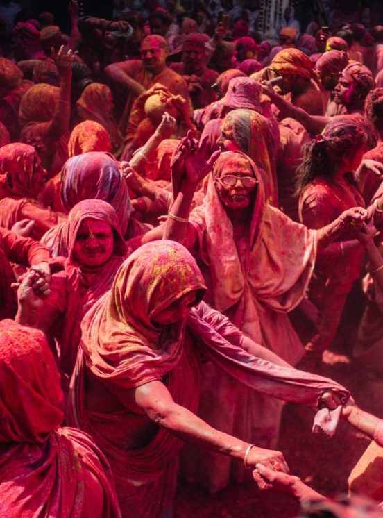 Hindu women celebrate Holi and are covered in colour powder